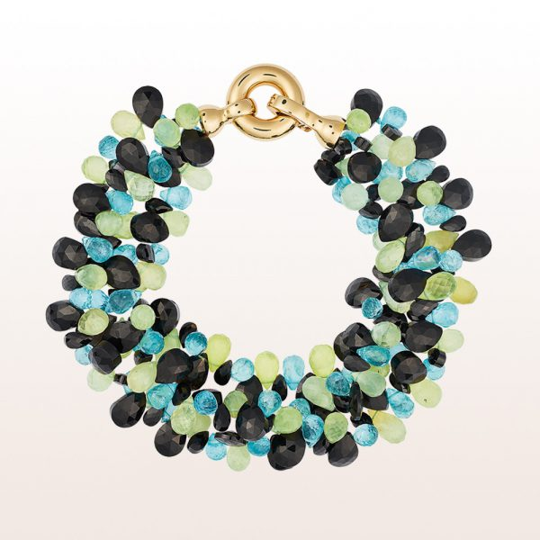 Bracelet with prehnite, apatite, onyx and an 18kt yellow gold clasp