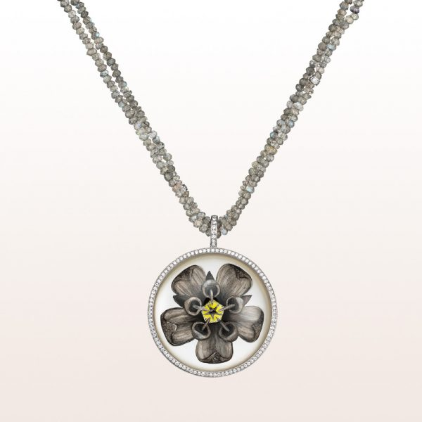 Pendant with rock crystal, mother of pearls and diamonds 0,44ct on a necklace with labradorite in 18kt white gold