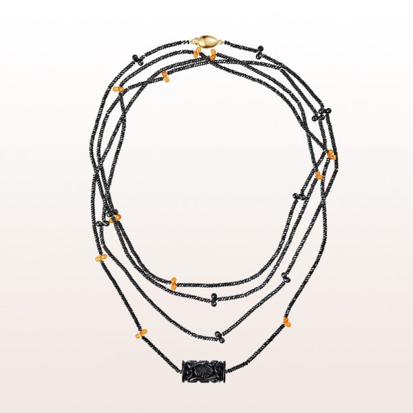 Necklace with carved onyx, black spinel, mandarin garnet and an 18kt yellow gold clasp