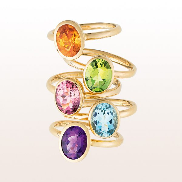 Ring-collection with mandarine-garnet, peridot, rubellite, aquamarine, amethyst in 18kt yellow-, white-, and rose gold